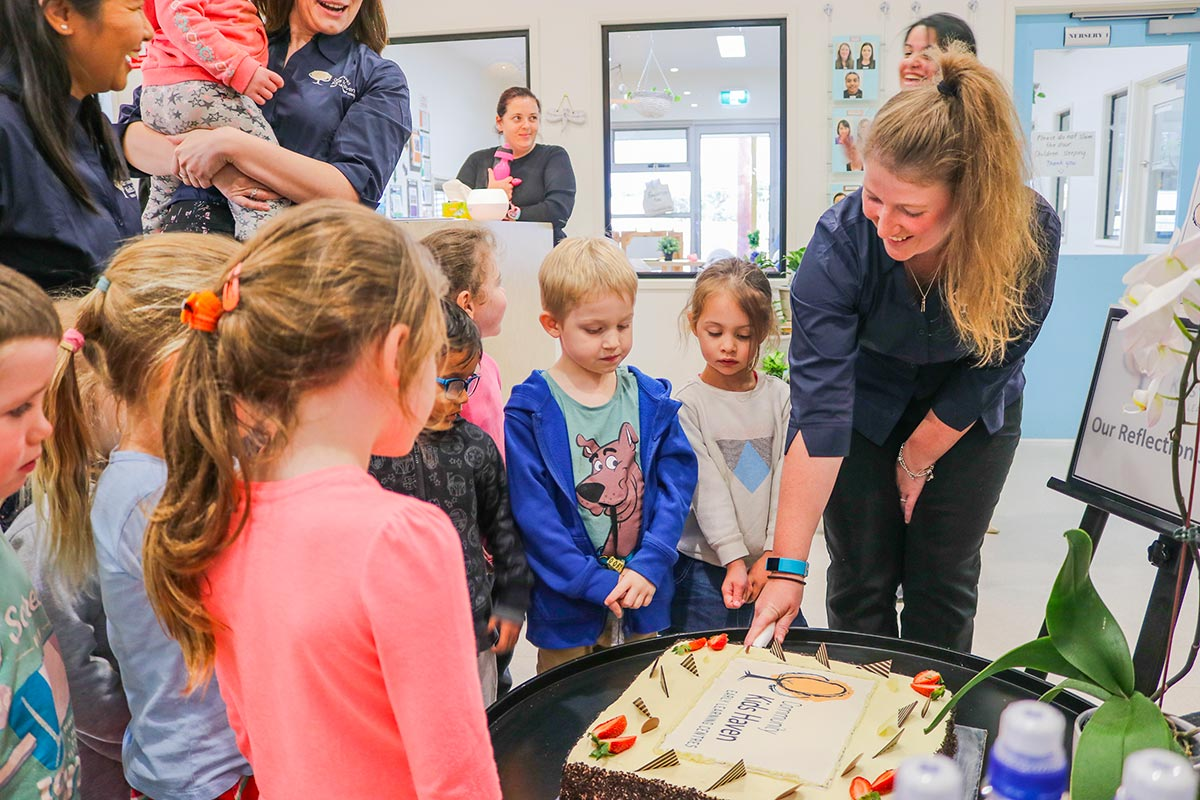 cutting cake for event opening new childcare centre